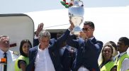 portugal team getting off plane with euro 2016 trophy. ronaldo and santos