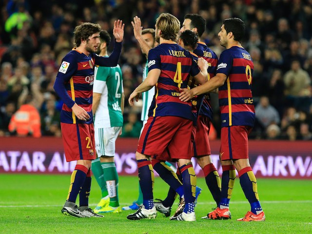 Barcelona players celebrate after an own goal of Real Betis' German defender Heiko Westermann during the Spanish league football match FC Barcelona vs Real Betis Balompie at the Camp Nou stadium in Barcelona on December 30, 2015. AFP PHOTO/ PAU BARRENA / AFP / PAU BARRENA (Photo credit should read PAU BARRENA/AFP/Getty Images)