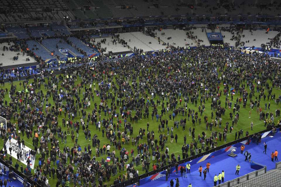 Spectators gather on the pitch of the Stade de France stadium following the friendly football match between France and Germany in Saint-Denis, north of Paris, on November 13, 2015, after a series of gun attacks occurred across Paris as well as explosions outside the national stadium where France was hosting Germany. At least 18 people were killed, with at least 15 people killed at the Bataclan concert hall in central Paris, only around 200 metres from the former offices of Charlie Hebdo which were attacked by jihadists in January. AFP PHOTO / FRANCK FIFEFRANCK FIFE/AFP/Getty Images