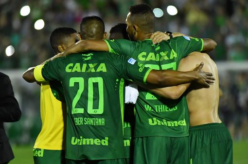 Brazil's Chapecoense footballers celebrate after defeating Argentina's San Lorenzo.