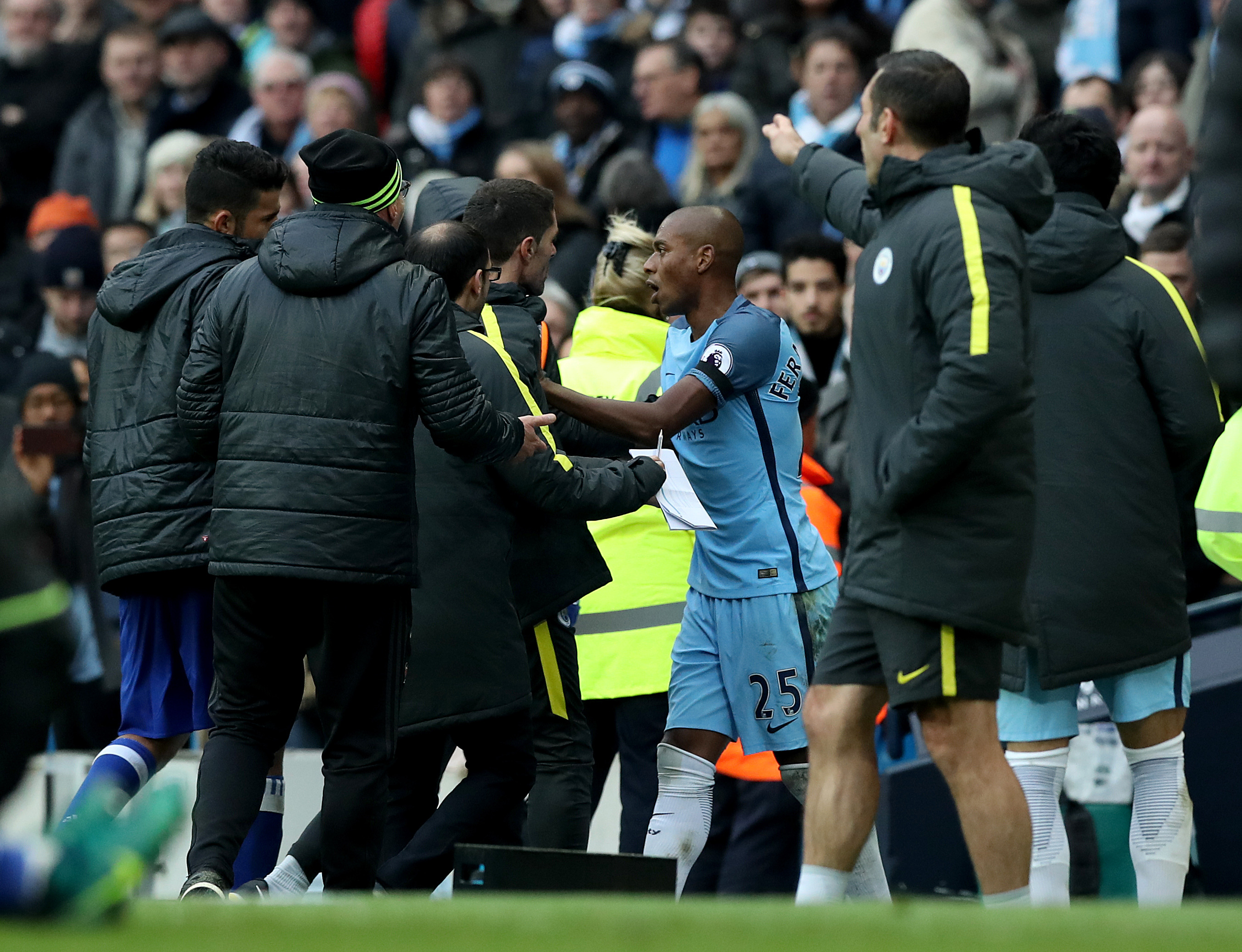 Manchester City's Fernandinho (centre) has some words as he is sent-off during the Premier League match at the Etihad Stadium, Manchester.
