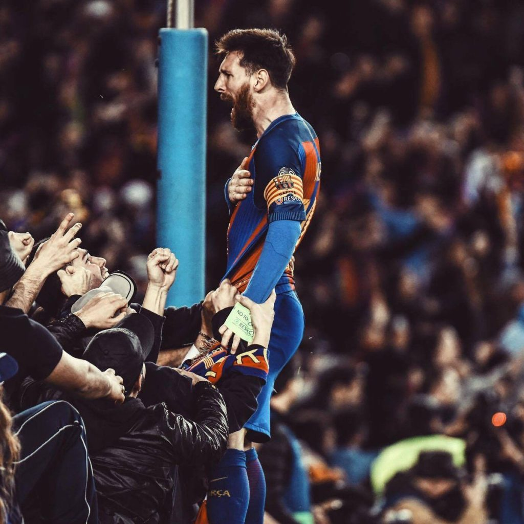 Lionel Messi celebrates their victory at the end of the UEFA Champions League round of 16 second leg football match FC Barcelona vs Paris Saint-Germain FC at the Camp Nou stadium in Barcelona on March 8.