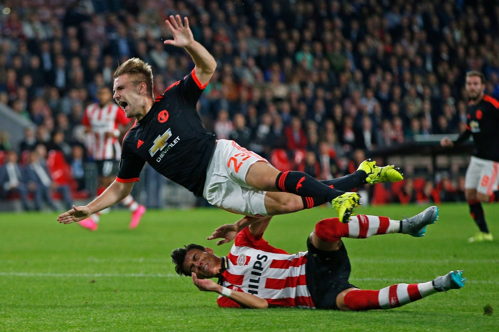 PSV's Hector Moreno lunges into Luke Shaw leading to an awkward landing