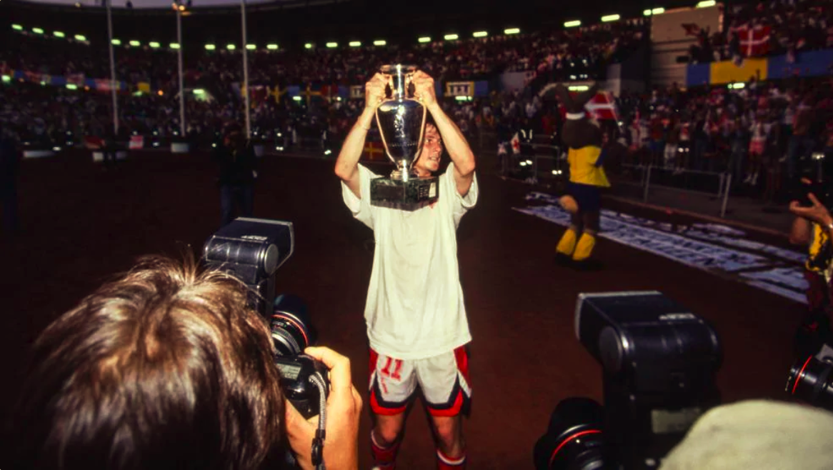 Brian Laudrup lifting the Euro 1992 trophy