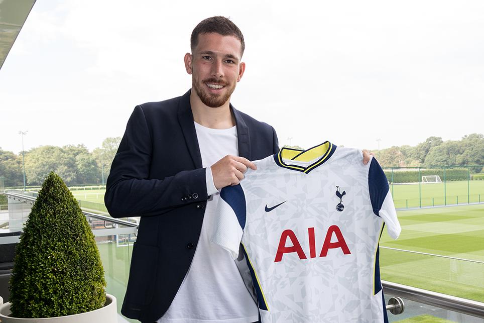 Pierre Emile Hojberg holding Tottenham jersey after transfer