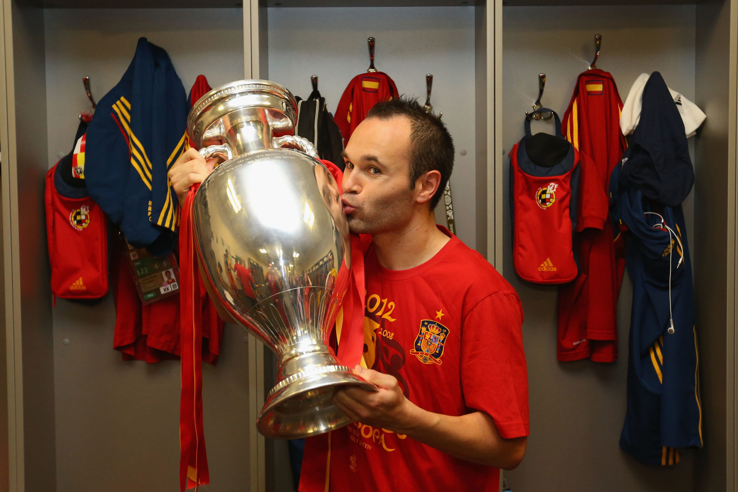 Andres Iniesta holding the Euro 2012 trophy in Spain's dressing room