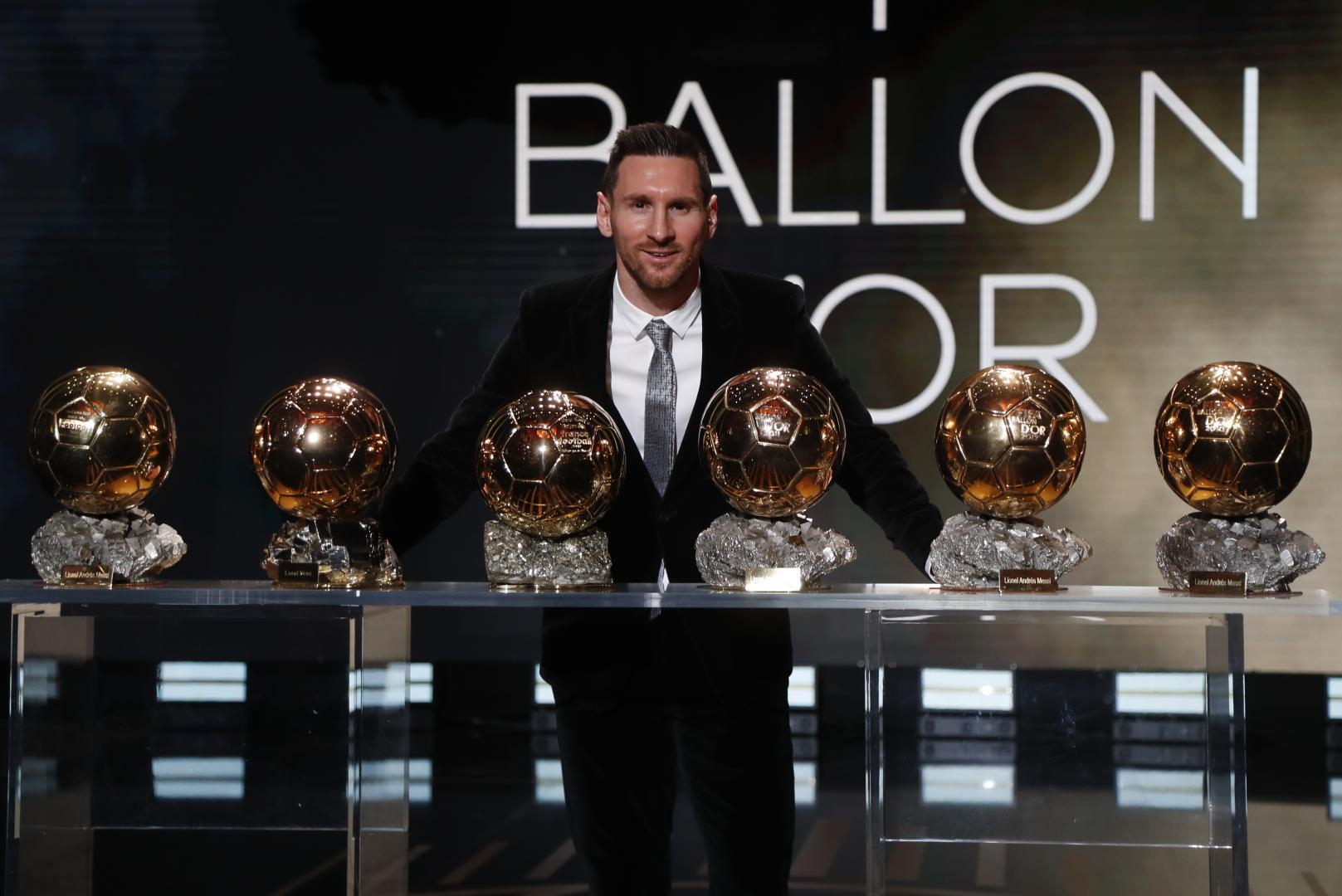 Lionel Messi poses with his six Ballon d'Or trophies