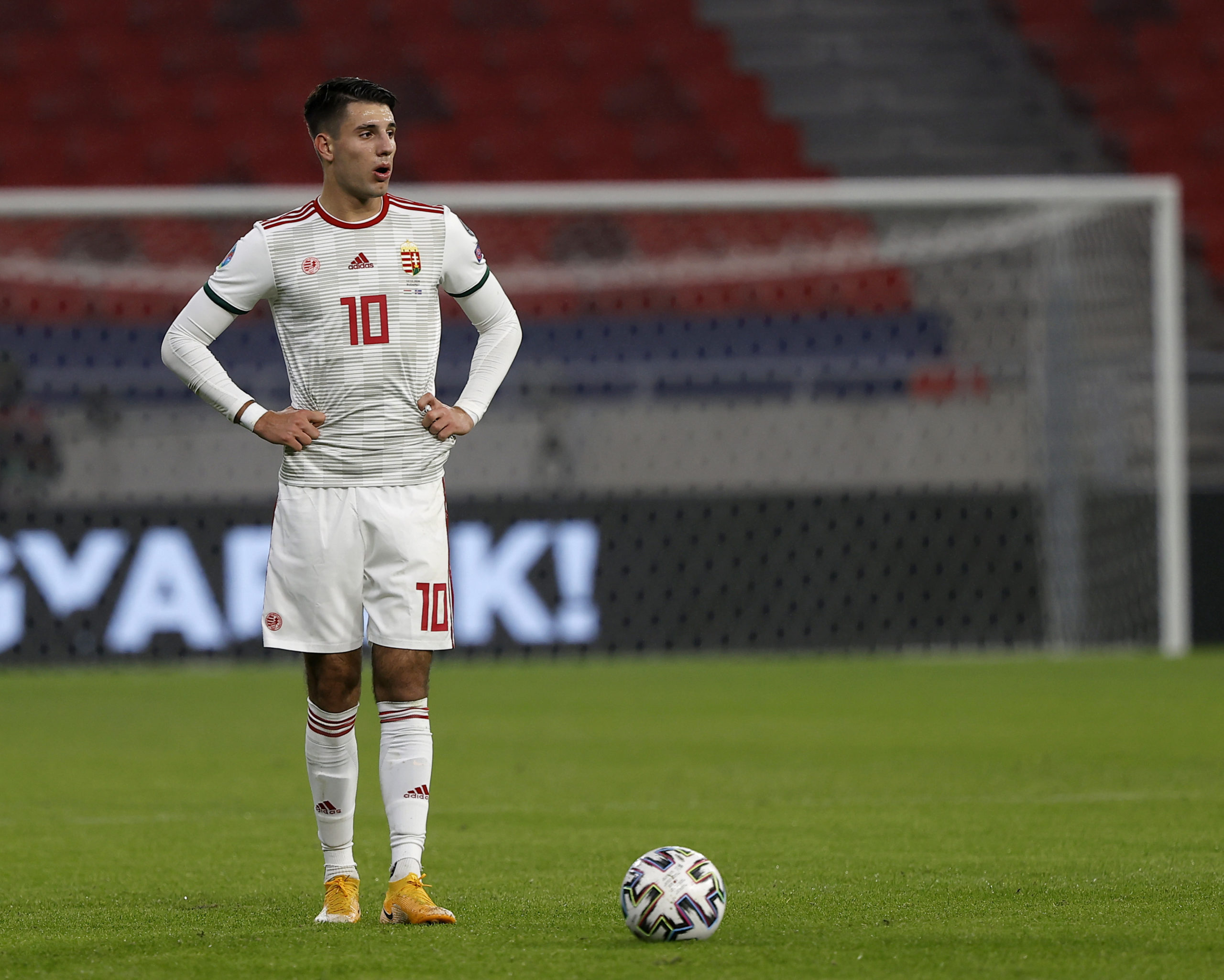 Dominik Szoboszlai stands on the ball as to take a free-kick for Hungary
